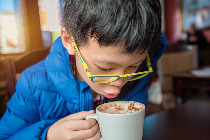 boy drinking hot cocoa chocolate